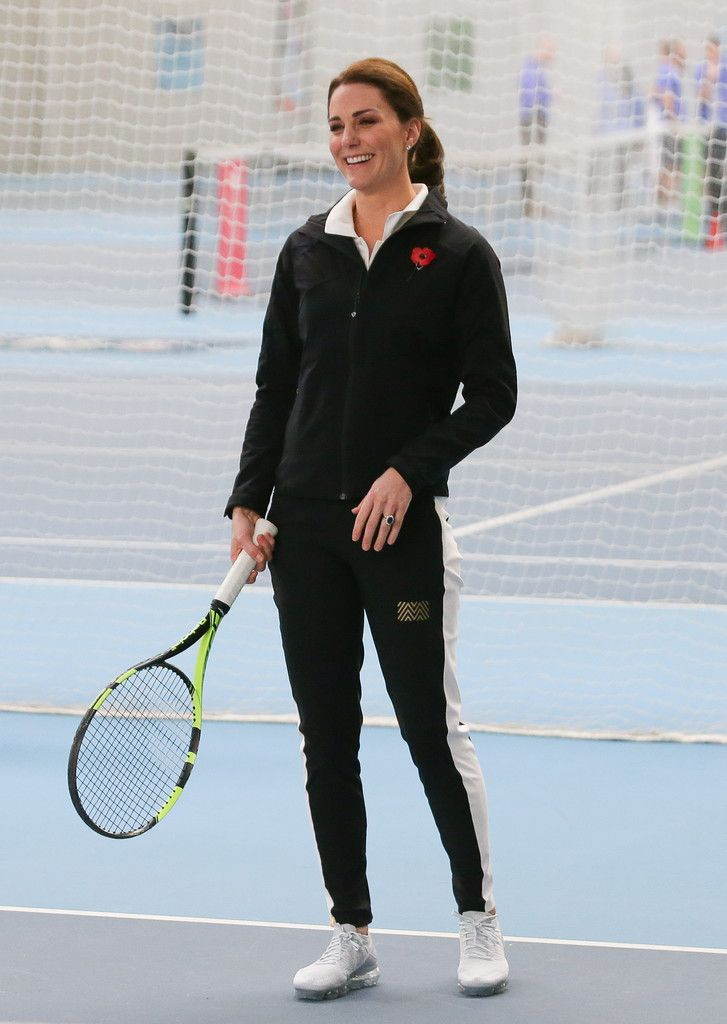 Kate Middleton Photos - Catherine, Duchess of Cambridge, takes part in a Tennis for Kids session during a visit at the Lawn Tennis Association (LTA) at the National Tennis Centre on October 31, 2017 in southwest London, England. The Duchess of Cambridge, who became Patron of the LTA in December 2016, visited the LTA, the national governing body of tennis in Great Britain, where she was briefed on the organisations latest activities and objectives, and had the opportunity to watch a number…