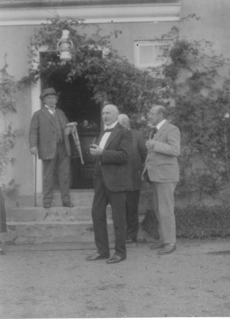 """Johannes Bucholtz visiting The Jenle Festival 1929 - to the left on the stairs  his friend author Jeppe Aakjær, the organizer of """"The Jenle Festival"""" and owner of Jenle House. Just one year later on the 22nd April 1930 Aakjær died from a heart attack, just like Bucholtz did another decade later the 5th August 1940. I do not know the name of the gentleman in the middle of the picture? Perhaps minister for social affairs KK Steincke?"""