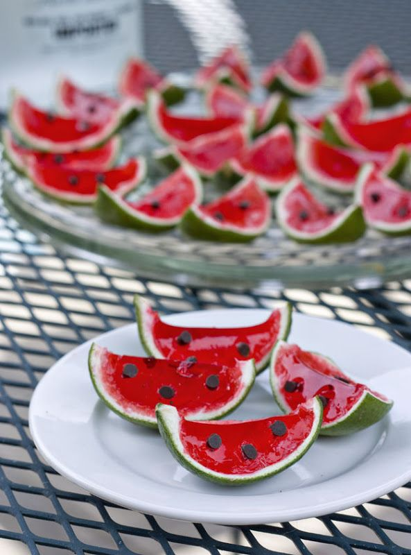 Watermelon Lime Jello Shots (40) 10 limes, pulp removed 1 box red Jello   1 cup boiling water 1 cup cold vodka  Mini chocolate chips  Halve limes, remove the pulp.  Add 1 cup of boiling water to the Jello  and stir for until dissolved. Stir in cup of cold vodka. Pour mixture into lime halves, chill. Cut each lime half in half again, making wedges. Stick in chocolate chips