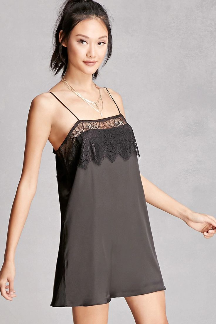 A satin slip dress featuring an eyelash lace flounce layer, cami straps, and a square neckline. This is an independent brand and not a Forever 21 branded item.
