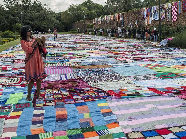 People view blankets gathered for the Nelson Mandela Day project at the Union Buildings in Pretoria, South Africa. A project titled 67 Blankets is attempting to set a new Guinness world record for the largest area covered by blankets. Stefan Heunis, AFP/Getty Images