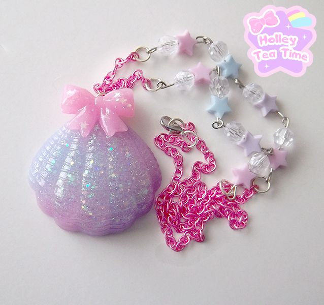"""☆ made from resin, glitter, paint, plastic star beads, crystal plastic beads, and pink color chain  ☆ shell is pink, blue and lilac with a pink bow ☆ sea shell size: 5.5 cm x 5.5 cm (2.1"""" x 2.1"""") ☆ necklace sparkles a lot from glitter  ☆ chain length: 64 cm (25.1"""")  ☆ handmade product"""