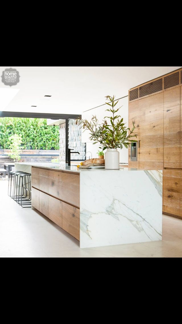 Love this island, I'd have a pure white bench top instead of the marble
