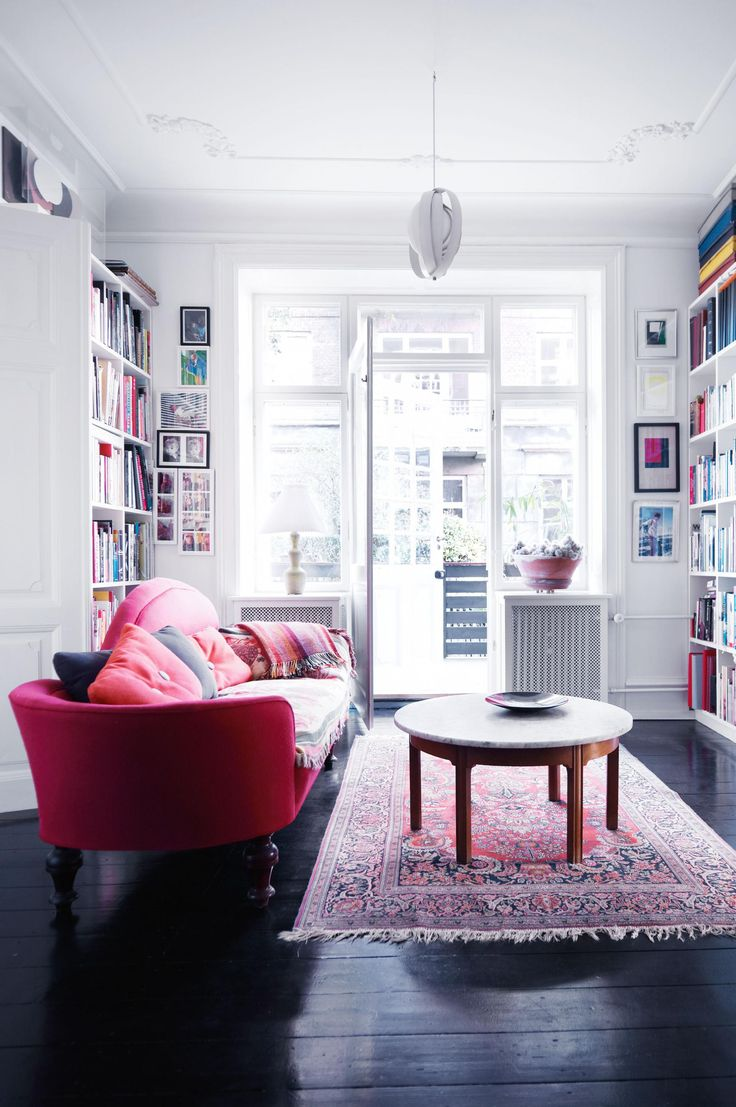 IOT0115OSEAS_09 Copenhagen Apartment Living Room Red Couch Dark Floorboards  Rug Bookcases Part 41