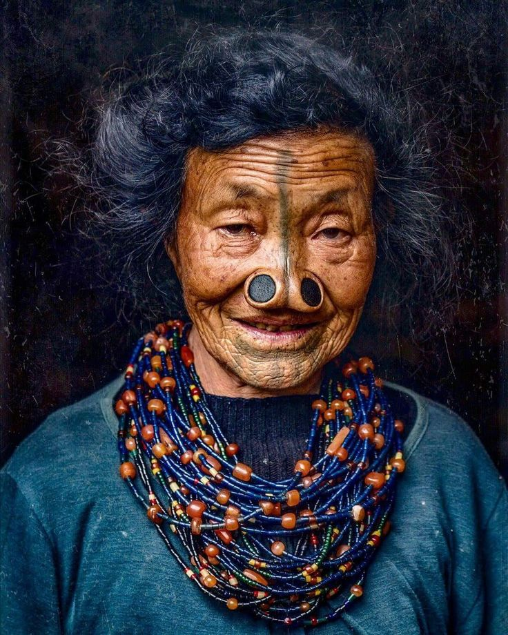 """The """"nose plugs"""" and the face tattoos of an Apatani woman on October 2016 in Ziro Valley, Arunachal Pradesh, India."""