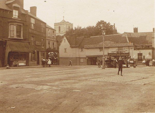 Church Street, Waltham Abbey, showing the Welsh Harp PH with Abbey Tower behind.