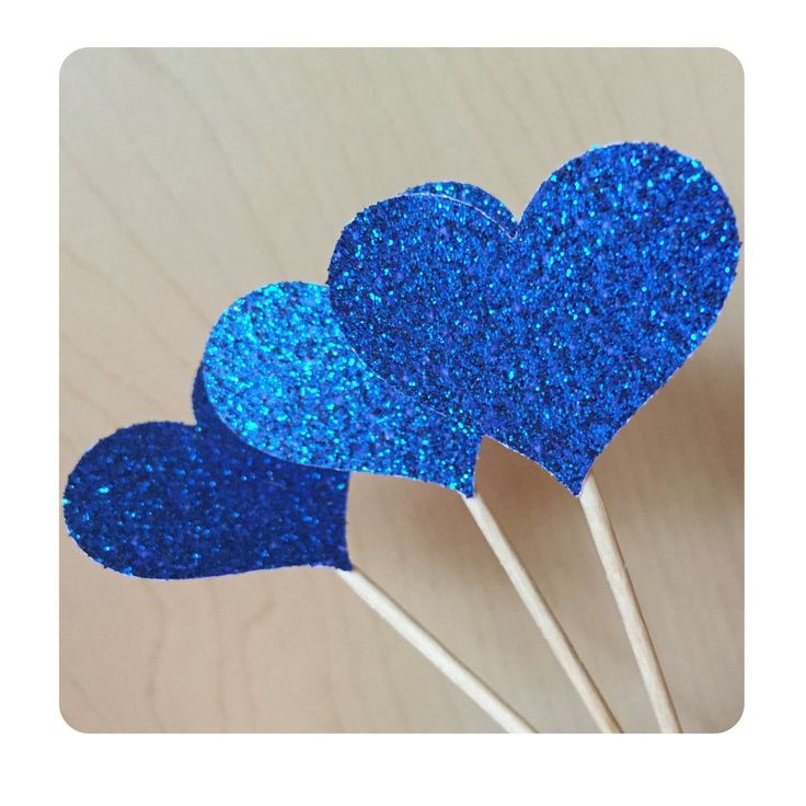 A personal favorite from my Etsy shop https://www.etsy.com/listing/129707776/12-sparkling-royal-blue-heart-cupcake