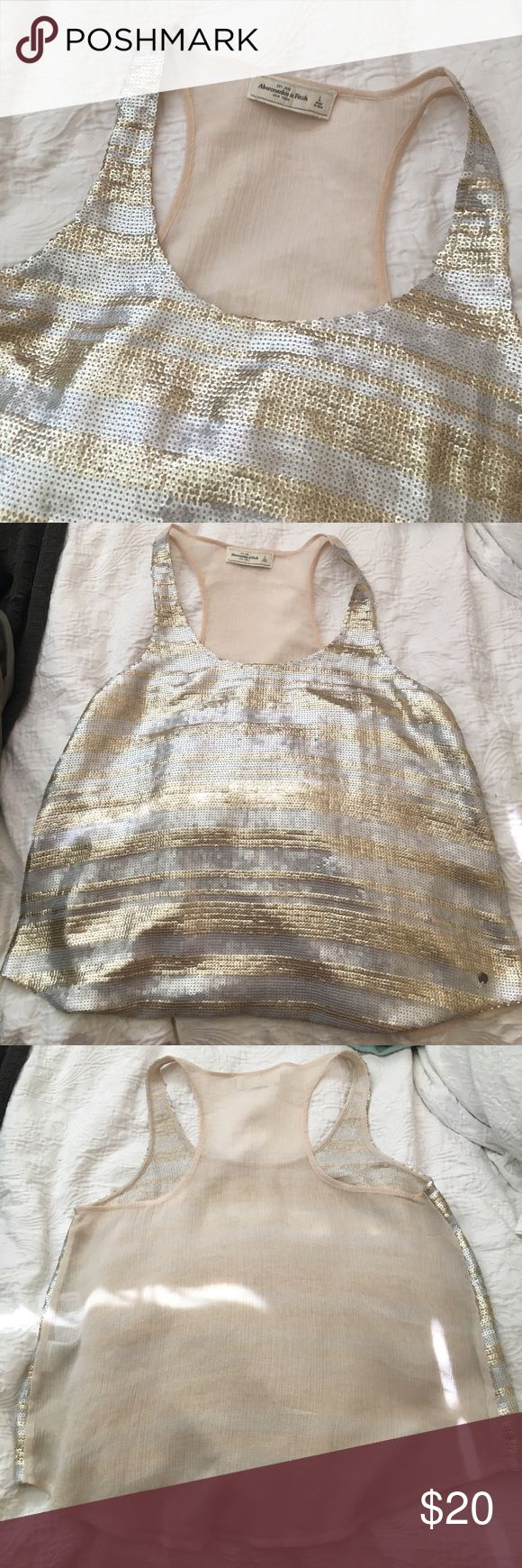 Abercrombie and fitch sequin tank top gold silver Racerback tank top from Abercrombie and fitch. Size l. Sequin all over the front. See through back. Abercrombie & Fitch Tops Tank Tops