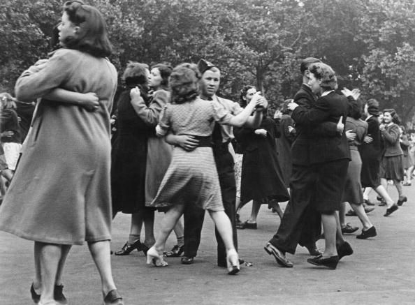 People dancing in Southwark Park, south London, during World War II, 1942. The dance is one of several events organised in the UK, to discourage people from travelling abroad for the summer during wartime. Original Publication : Picture Post - 1182 - How To Spend A Holiday In London - pub. 1942 (Photo by Felix Man/Picture Post/Hulton Archive/Getty Images)