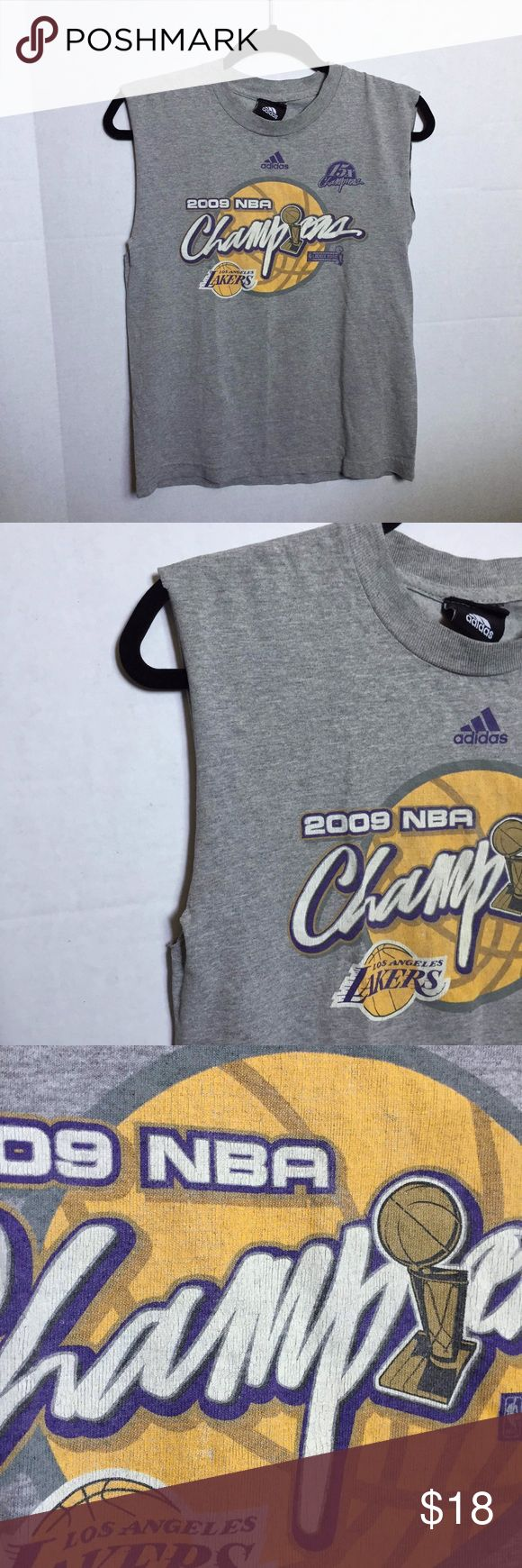 LA Lakers Shirt🌞 I cut sleeves off and turned it into a muscle tee. Tag is falling of and has no size. Might be a Men's Small. Can fit up to a Women's Medium. Logo is crackling a little. adidas Tops Muscle Tees