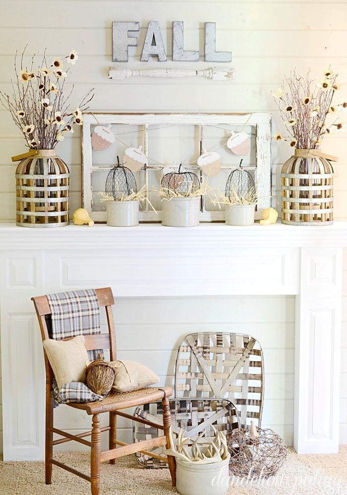 Amazing farmhouse style mantel for fall! Do you love neutral decor and incorporating textures? This mantel has it all! Check out the details at dandelionpatina.com #farmhousestyle #neutraldecor #fallmantel