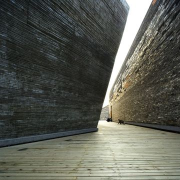 Amateur Architecture Studio. Ningbo History Museum, 2003-2008. Ningbo, China. Photo by Lv Hengzhong.