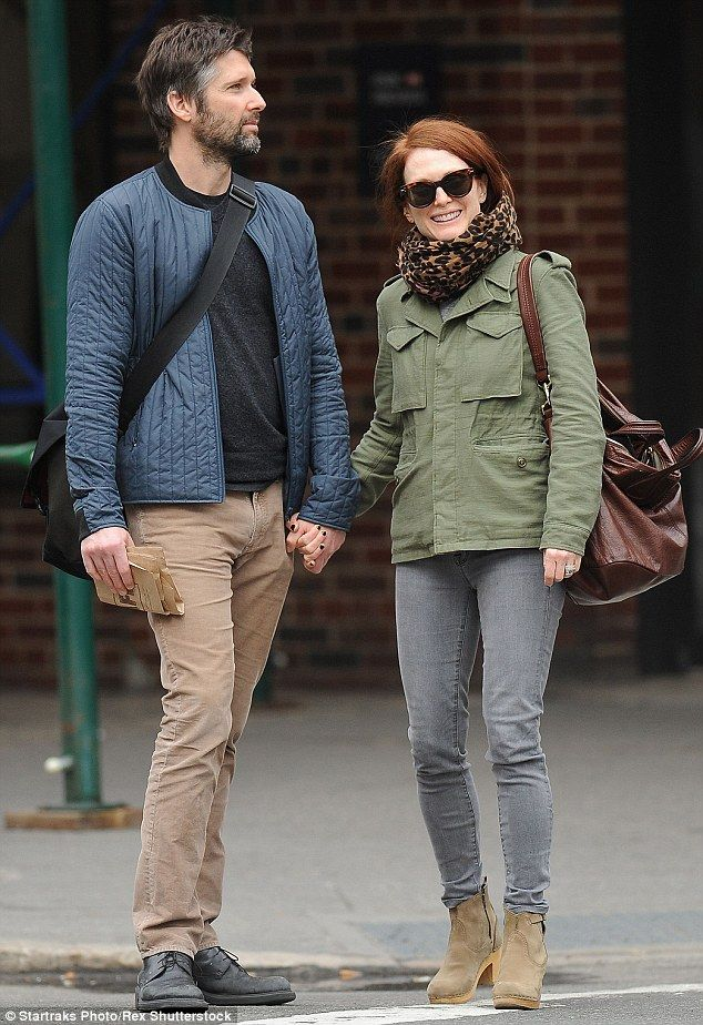 Romantic stroll: Julianne Moore and husband Bart Freundlich looked very much in love as they took a walk in New York City together on Tuesday