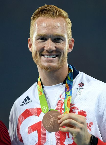Greg Rutherford of Great Britain poses with the poses with the bronze medal for…