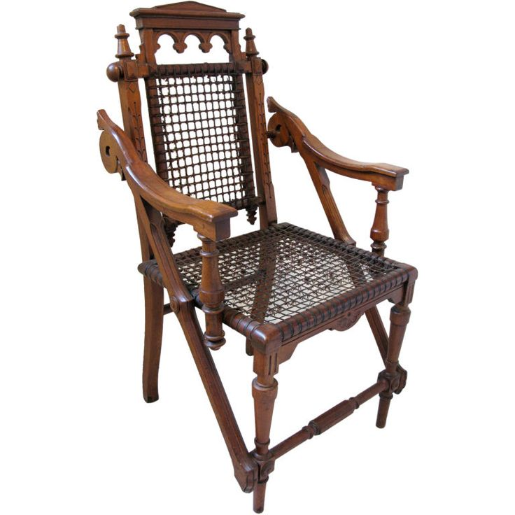 1870 wooden armchair by George Hunzinger. The unusual chair has design elements of both the Moorish and Renaissance revival.