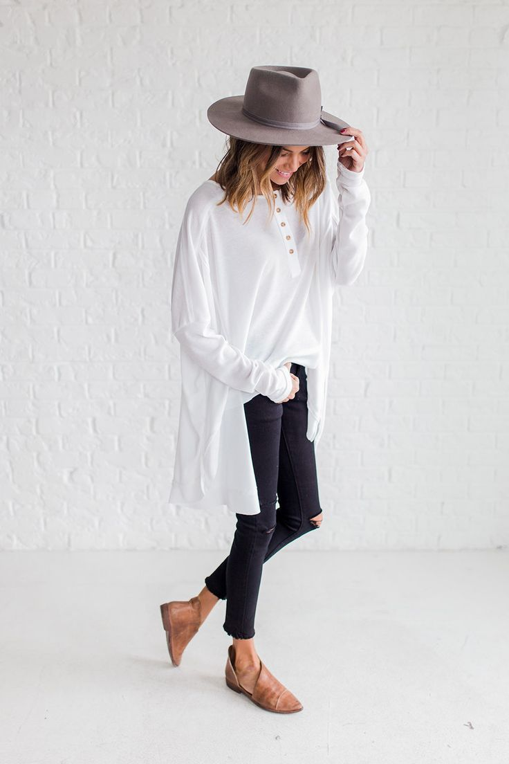 DETAILS: - Boxy thermal white top - High front and low back detail - Functional buttons on front - Model is wearing a small