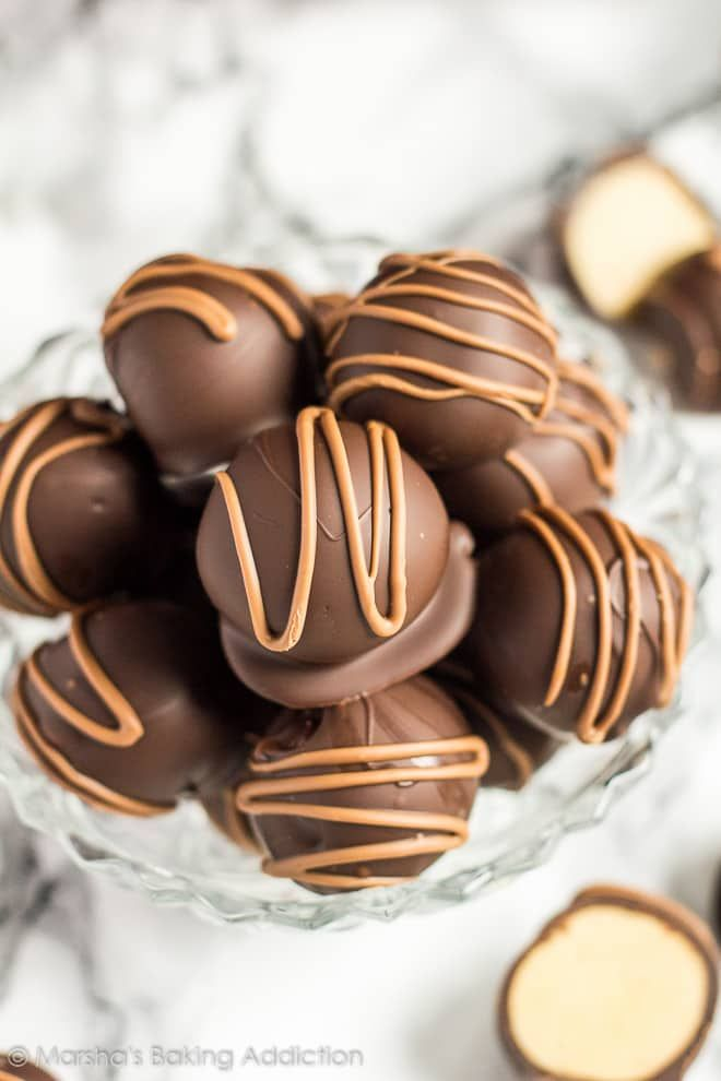 No-Bake Peanut Butter Truffles - Deliciously creamy bite-sized peanut butter balls, coated with dark chocolate, and drizzled with milk chocolate!