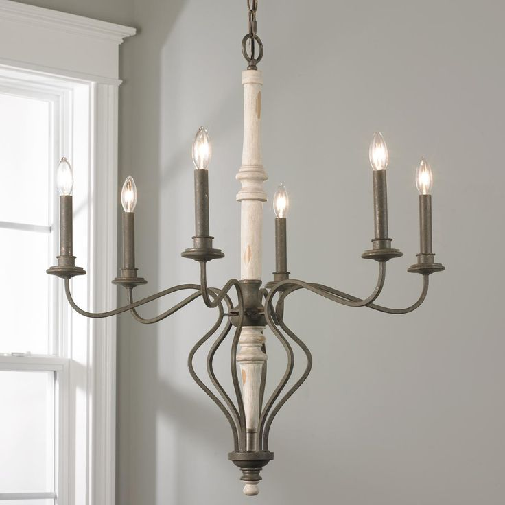 French Country Curve Chandelier- Small This French Country chandelier merges the modern style of the angular arms with the beautiful rustic feel of the wooden Whitewash center column. 6x60 watt max candle base sockets. (32Hx28W).