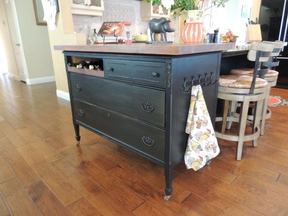 Meet Aubrey, a gorgeous one-of-a-kind, vintage kitchen island. Aubrey started out in the 1930s as a large solid cherry wood dresser, and we have repurposed her into a stylish yet functional centerpiece for your vintage kitchen. We painted her a deep black chalk paint, gently distressed her, and added a warm auburn glaze for a beautiful antique effect. She has been sealed with wax. She has original antique hardware that has been painted oil rubbed bronze. She has 3 roomy drawers for kitchen…