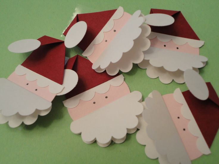 Santa Christmas gift tags. A couple colors of card stock, some punches, and glue adhesive!