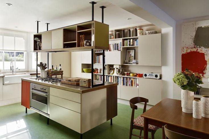 The kitchen, with green marmoleum flooring.