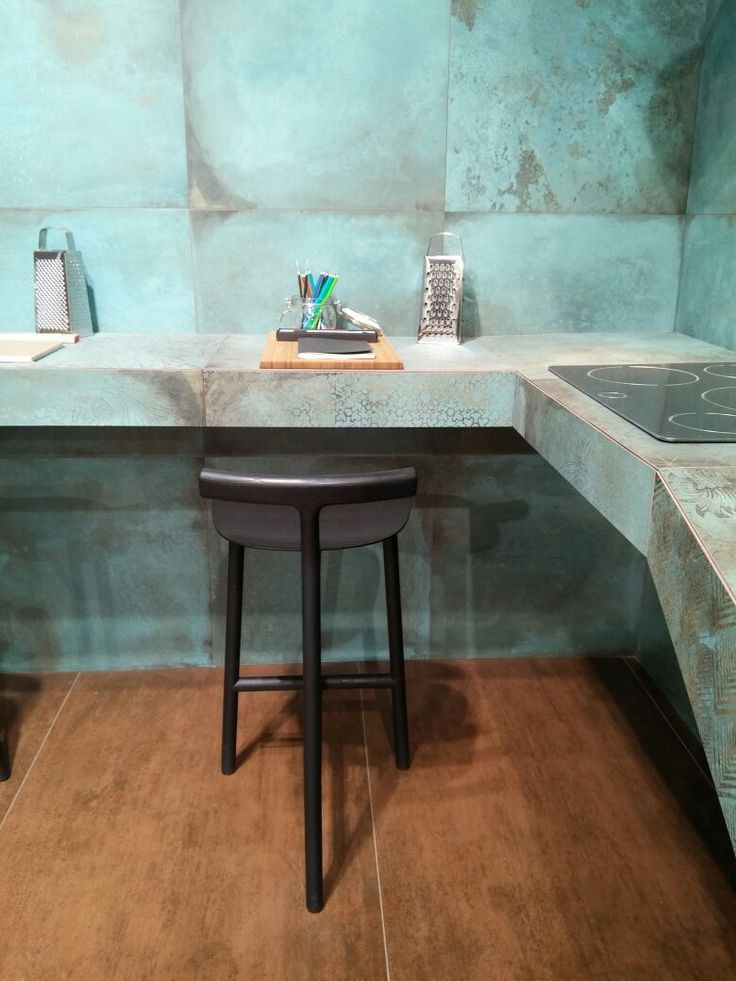 Enjoy a modern #kitchen with innovative wall #tiles that evoke the metal oxided effect and a floor #tile wood effect!