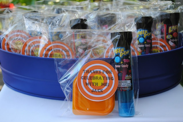 Laser tag party favors - trying to tie the laser tag activity he requested with the sports themed cake he wants.