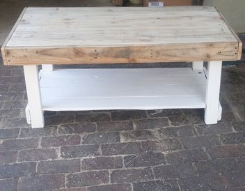 Custom Designed Pallet Coffee Table. Clear coat on top and white enamel on bottom.