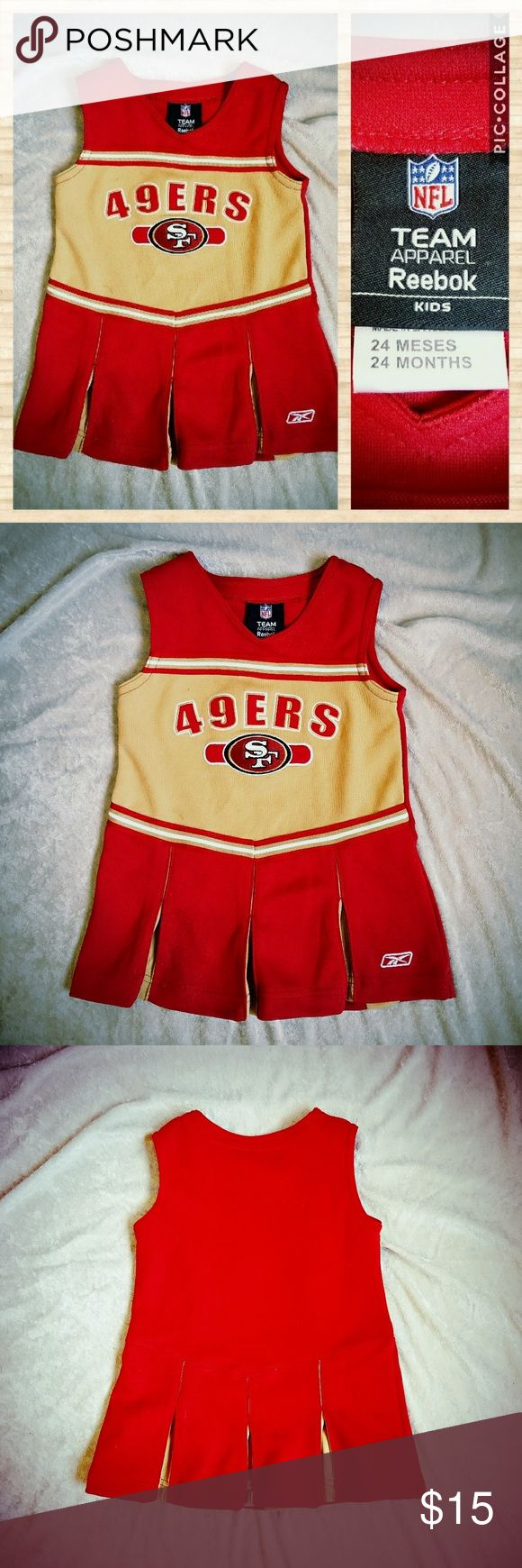 NFL 49ers cheerleader dress for baby girl, sz 24mo Adorable cheerleader-style dress for baby/toddler, perfect for your littlest 49ers fan! Used but in good condition. Closeup photos show two tiny stains on the front and loose thread at the waist on back. An easy, one-minute patch-up with needle and red thread.  This design is retired and no longer available for sale anywhere! 100% knit polyester, sport jersey material.  I believe this dress originally included matching bloomers; price is…