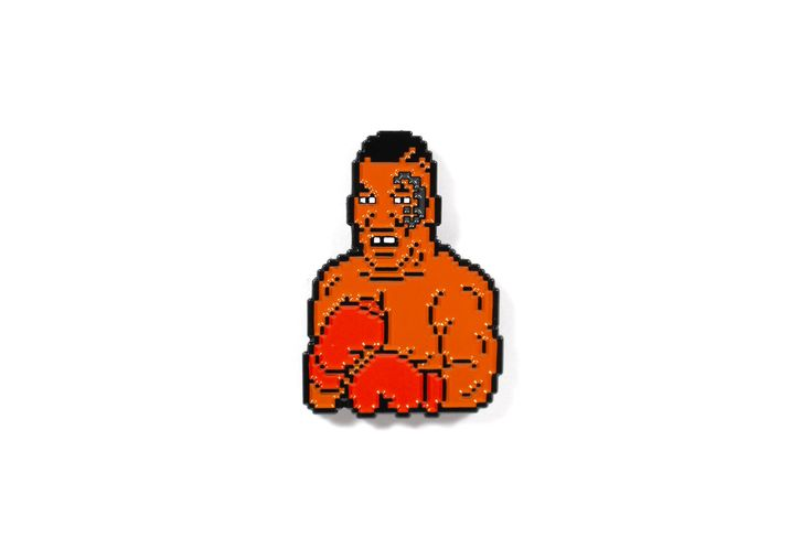 """You might remember him from the classic video game """"Mike Tyson's Punch Out"""" it's Iron Mike Tyson himself in all his 8-bit glory with a modern twist of his face tattoo! A must have for not just pin collectors but die hard video game enthusiasts as well.    Size - 1.5""""  Soft Enamel  Dyed Black Meta..."""