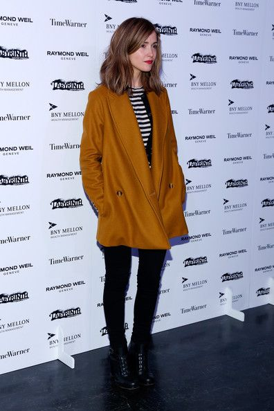 Rose Byrne | mustard yellow long double-breasted jacket + striped black and white shirt + black skinny jeans + combat ankle boots