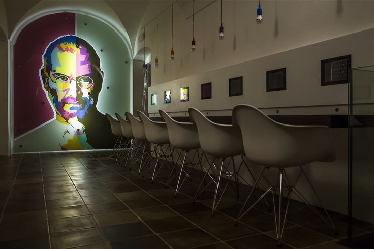 A sneak peek of the Apple Museum interior featuring the Steve Jobs mural and an army of Dario molded plastic chairs. #Apple #SteveJobs #iPhone #Museum #Prague #Czech #CzechRepublic #Europe #World #Travel #Pixar #Next #Collection