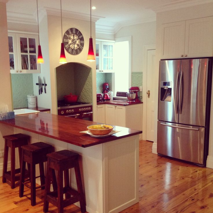 wood bench top. Pressed tin splash back. White sink. stainless steel ...