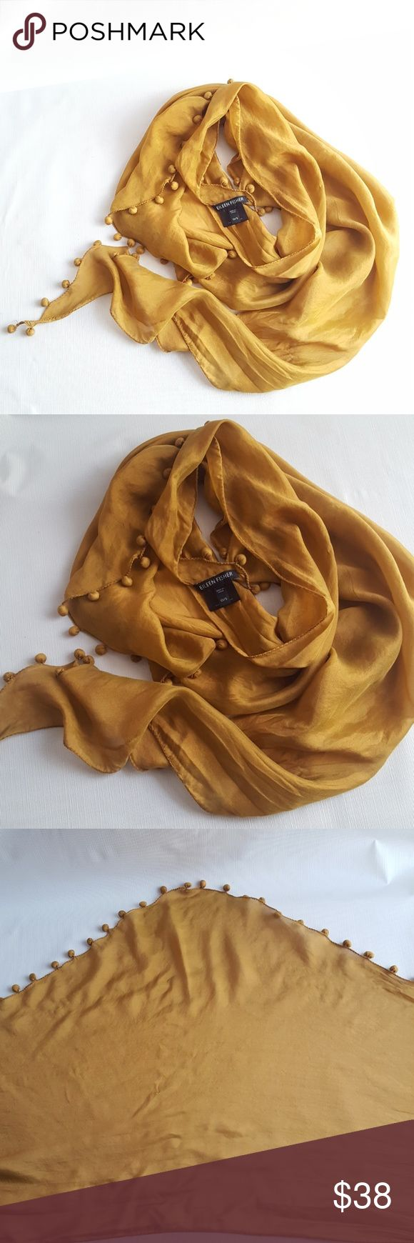 Eileen Fisher Silk Tassle Shawl Scarf In excellent preloved condition, iridescent honey mustard silk scarf, with pompom tassles. Eileen Fisher Accessories Scarves & Wraps
