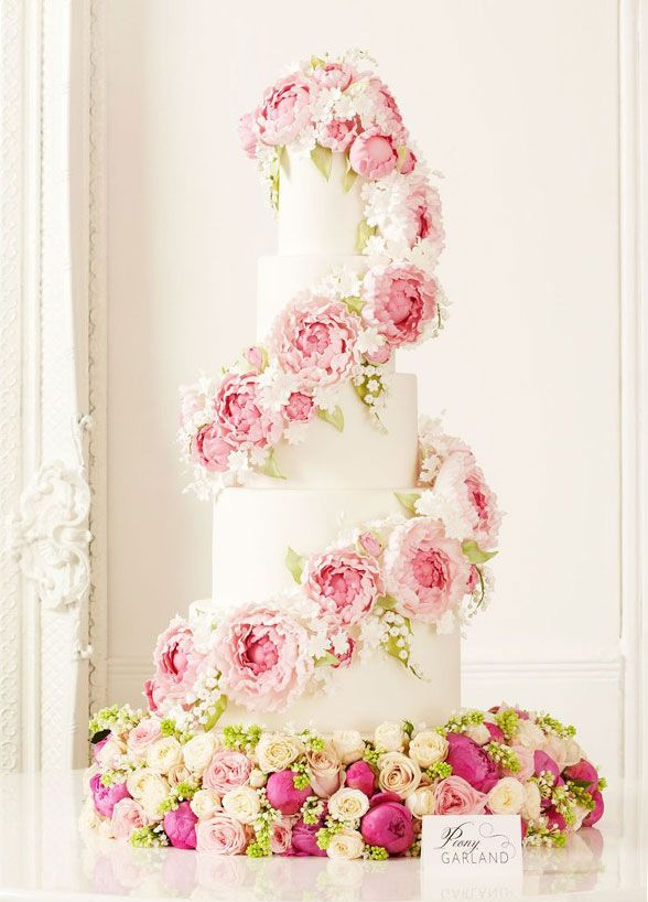 2. Cascading peonies and a fresh floral base make this cake looks as if it sprouted up in a secret garden. Check out these 10 Prettiest Spring Wedding Cakes: http://www.colincowieweddings.com/articles/cakes/10-prettiest-spring-wedding-cakes