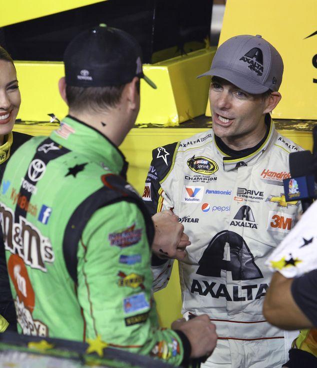 Congratulatory: Jeff Gordon, right, congratulates Kyle Busch after Busch won the NASCAR Sp...