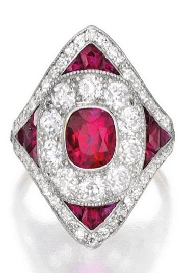 *** Unbelievable discounts on amazing jewelry at http://jewelrydealsnow.com/?a=jewelry_deals *** Platinum, Ruby and Diamond Ring, Marcus & Co. The kite-shaped design centring a cushion-cut ruby weighing approximately 1.40 carats, accented by old European and single-cut diamonds weighing approximately 1.25 carats, further decorated with calibré-cut rubies, signed M & Co., numbered, circa 1920. #Marcus #ArtDeco #ring
