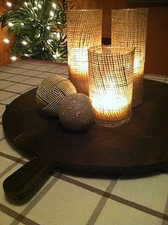 DIY burlap candle holders- so simple but nice effect! Rolled onto the
