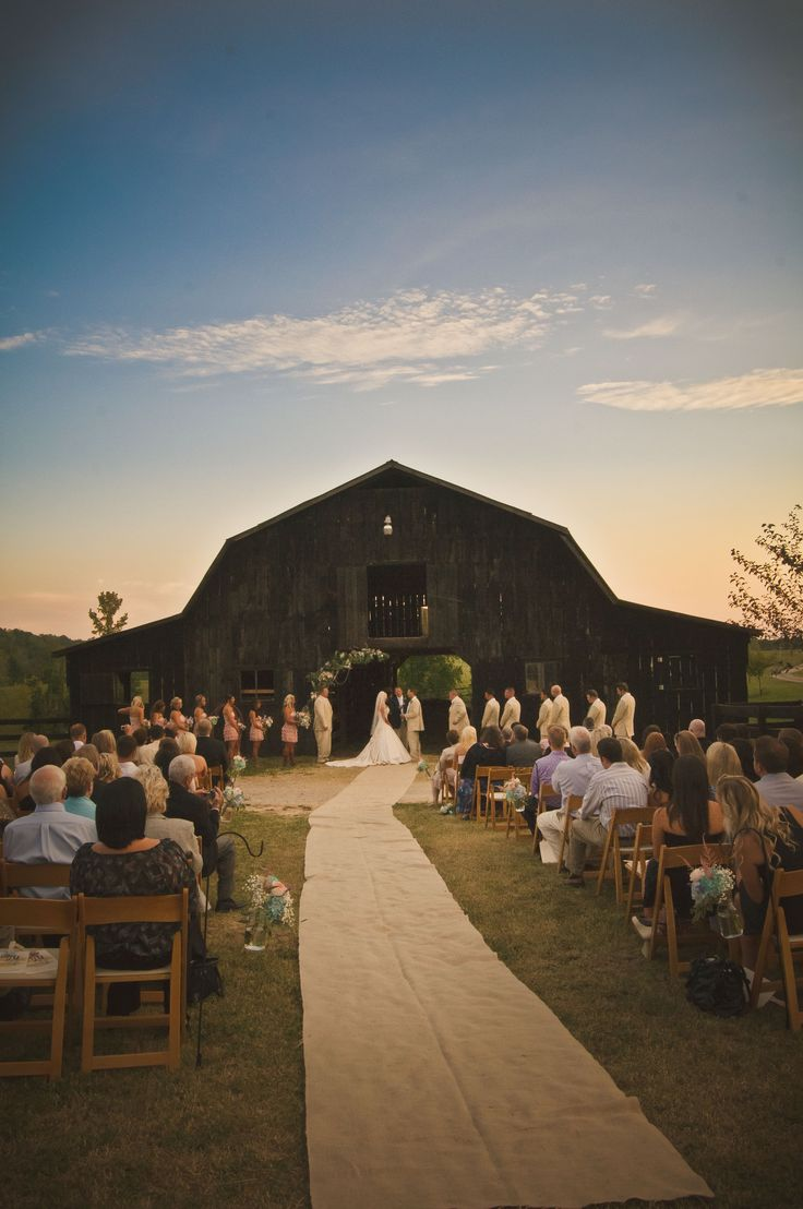 Burlap instead of silk aisle runner. Entire thing is beautiful. This would definitely be one of my top ceremony ideas with the barn and sunset.