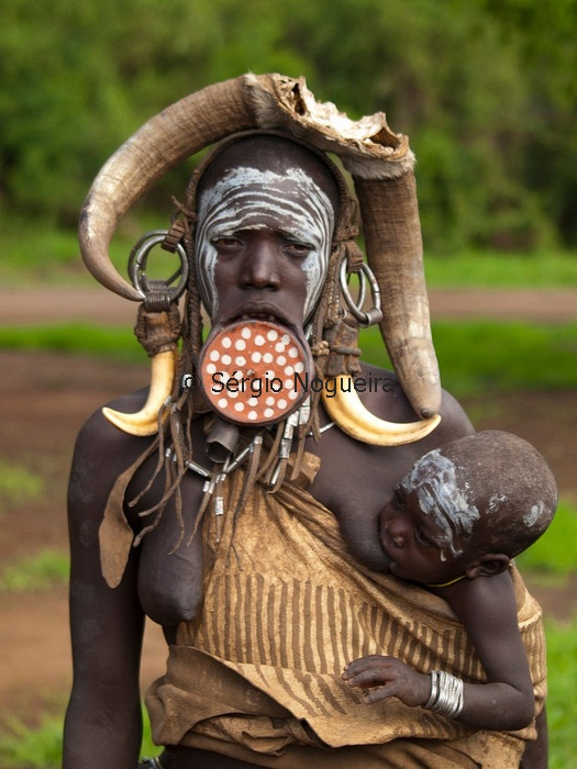 Mursi Woman Using A Lip Plate With Baby Nursing African