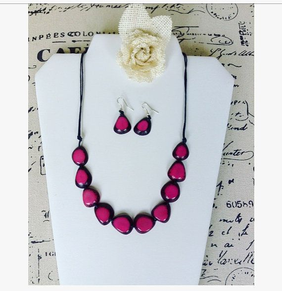 Hot pink bib necklace and earrings set made of Tagua nut. Eco friendly and sustainable. Made in Ecuador