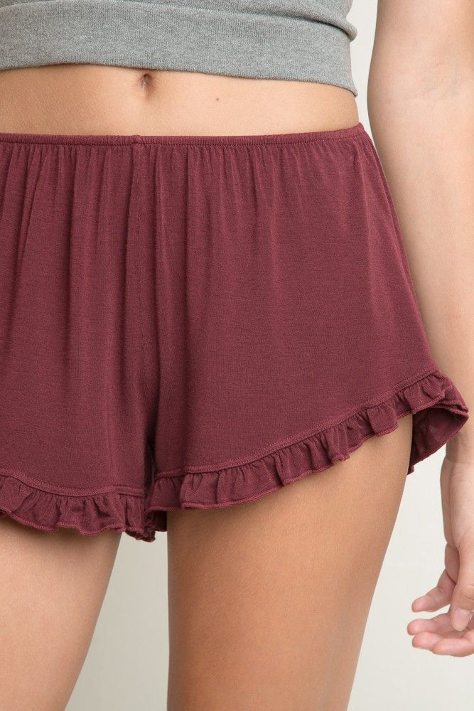 "Brandy ♥ Melville | Vodi Shorts VODI SHORTS $15 Ruffled trimming shorts with elastic waistband in a maroon color. Soft and slightly stretch cotton fabric. 57% cotton, 40% viscose, 3% elastane 8"" crotch, 11"" waist (stretch) Burgundy MLA038-59S0820000"