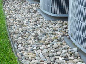 rocks around AC unit