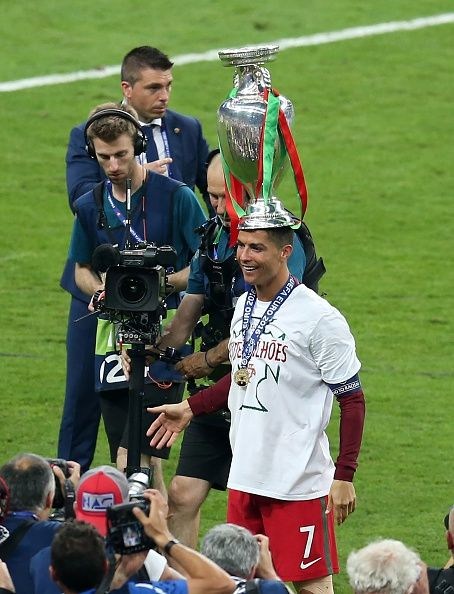 #EURO2016 Portugal's forward Cristiano Ronaldo pose with the trophy on the pitch after they won the Euro 2016 final football match between Portugal and France...