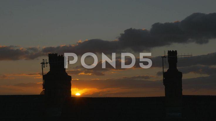 4k Orange Sunset Time Lapse Behind Chimney Rooftop Silhouette Dusk - Stock Footage | by RyanJonesFilms
