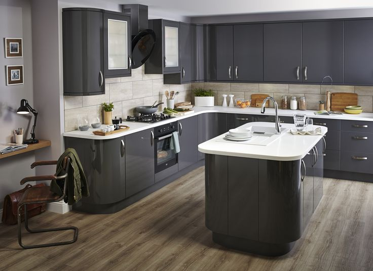 For a high-impact look with maximum character, our Santini gloss anthracite slab kitchen is bold and dramatic, softened with design-led curves. Absolutely Love the curves and smooth plain doors! This would be my perfect kitchen in either the cream or grey if the units reached all the way to the ceiling!
