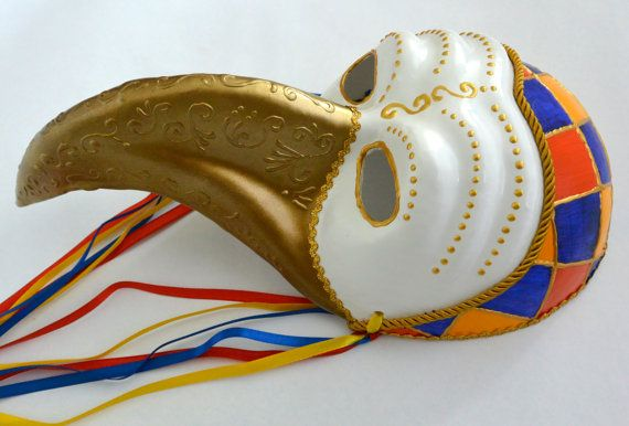 Venetian mask, handmade, paper mache, painted with acrylic, spray, cords, beads, colorful ribbons, synthetic feathers. It is used for decoration or to be used in Carnivals.
