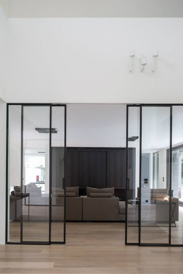 Beautiful steel sliding doors. Project VL by Dennis T'Jampens. Photo by Cafeine |Thomas de Bruyne.