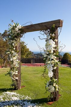 Railroad tie wedding arch while standing in flower pedals. Cute idea!! Beautiful archway