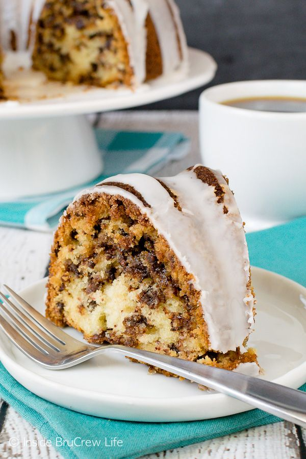 Sour Cream Chocolate Chip Coffee Cake - the sweet cinnamon sugar swirl and chocolate chips make this a decadent cake. Awesome recipe to make for breakfast or brunch. #breakfast #coffeecake #bundtcake #sweet #recipe #brunch